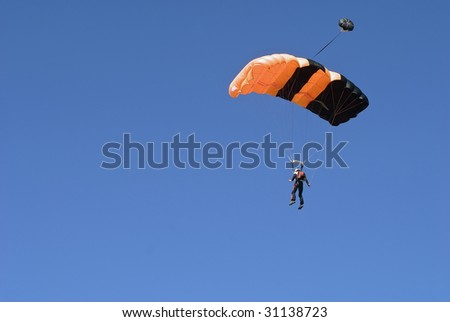 extreme sport  image of Parachute jumping over blue sky