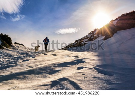 Extreme Sport. Lone hikers during winter in Romanian Carpathian mountains - stock photo