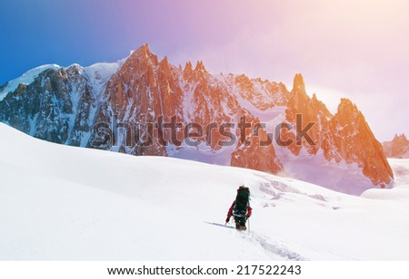 Extreme Sport. Lone hikers in winter mountains