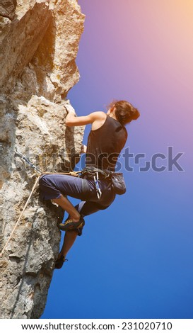 Extreme sport. The rock-climber during rock conquest