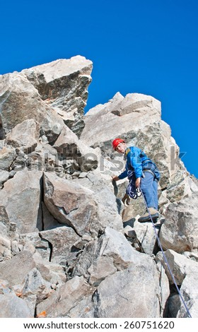 Extreme Sport. Young climber in the mountain - stock photo