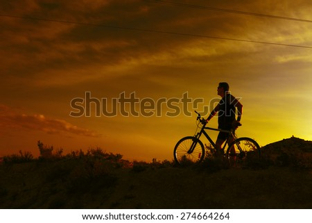 Extreme sports.Mountain bicycle and man.Life style outdoor extreme sport - stock photo