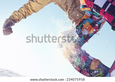Extreme sports: snowboarder flying in air, closeup - stock photo