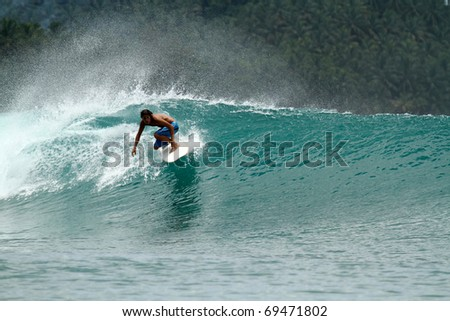Extreme surf sport, perfect wave on vacation - stock photo