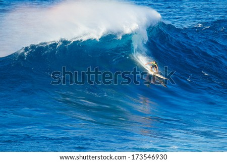 Extreme surfer riding giant wave  - stock photo