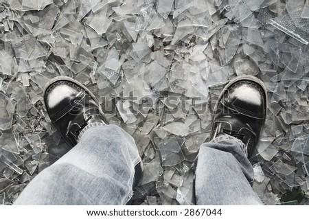 Extreme walking on smashed glass - stock photo