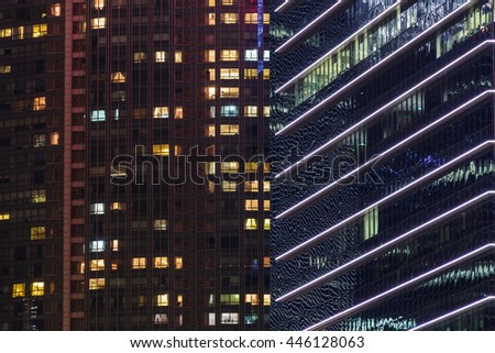 Extreme zoom of business buildings night scene in Singapore , Singapore cityscape of the financial district, Singapore