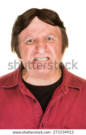 Extremely angry man in red with clenched teeth
