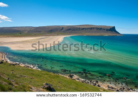 Extremely beautiful bay with mighty golden beaches and turquise sea in the West Fjords, Iceland.  - stock photo