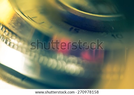 Extremely close up image of a vintage camera details, defocused background. - stock photo