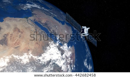 Extremely detailed and realistic high resolution 3D image of earth with deep space one spacecraft above Saudi Arabia. Elements of this image have been furnished by NASA - stock photo