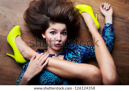Extremely flexible woman concept - stock photo