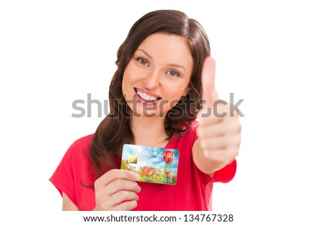 Extremely positive woman holding bank plastic credit or debit card and smiling - stock photo