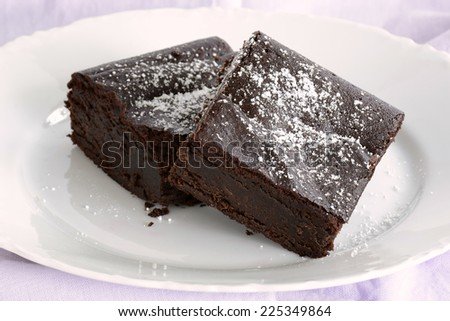 Extremely rich fudge chocolate brownies made without any grains, totally gluten free - stock photo