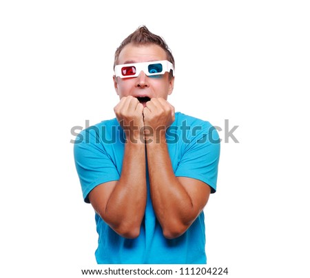 Extremely  scared man watching the movie in stereo glasses - stock photo
