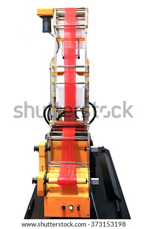 Extruder of polyethylene for process production of plastic bags. Desktop machine for micropacket - stock photo