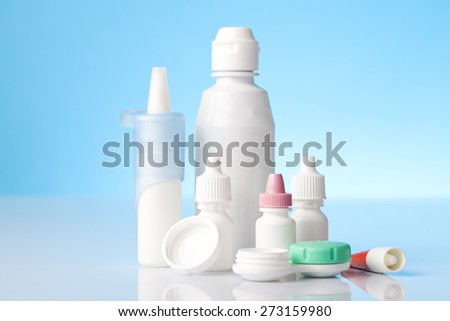 Eye and allergy treatment items on blue background - stock photo
