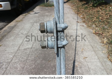 Eye bolt in the middle. Steel anchor bolt eye in sandstone rock. The fixed steel rope. Climbers path via f errata. Iron twisted rope fixed in block. - stock photo