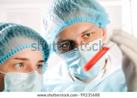 eye close-up of two technicians - stock photo