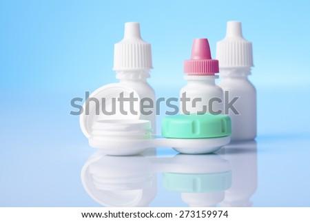 eye drop liquids on blue background  - stock photo