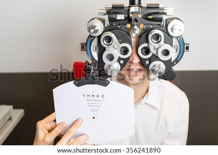 eye exam and eye test - stock photo