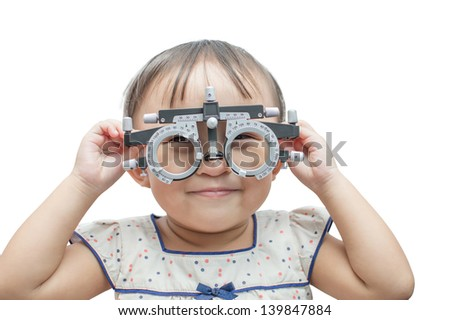 Eye examination and refraction, child.