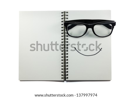 Eye glasses and binder notebook isolated - stock photo