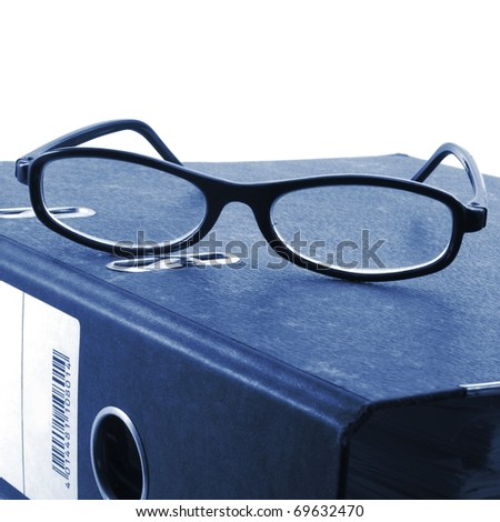 eye glasses and folder in the office showing paperwork concept - stock photo