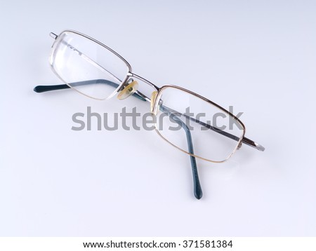 Eye glasses on a gray background