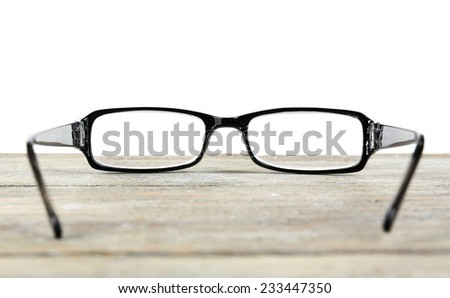Eye glasses on table on white background