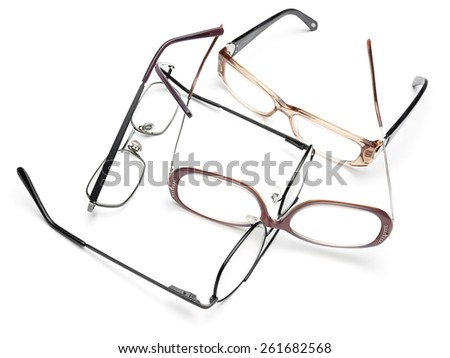 Eye glasses scattered in on the white background,for medicine,eye testing, vision themes - stock photo