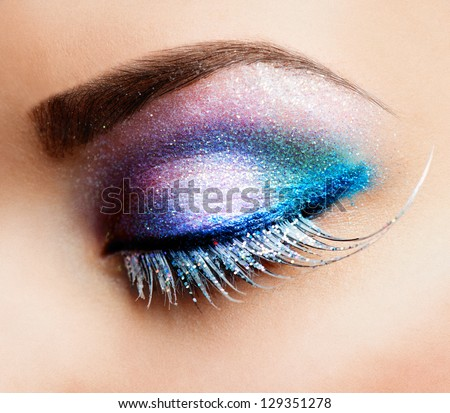 Eye Makeup. Beautiful Eyes Glitter Make-up. Holiday Makeup detail. False Lashes - stock photo
