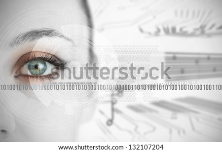 Eye of woman next to binary codes close up on circuit board background