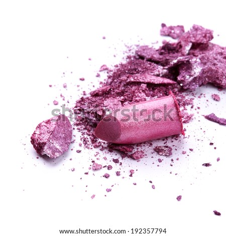 Eye shadow and lipstick over white background