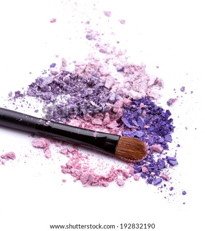 Eye shadow with brush over white background