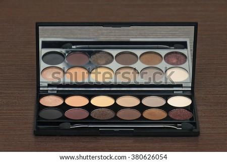 Eye shadows makeup palette kit with reflection in the mirror
