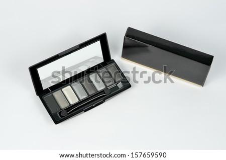 eye shadows palette with mirror and carton box - stock photo
