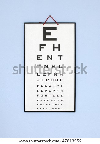 eye test chart - white optometry chart on the blue wall - stock photo
