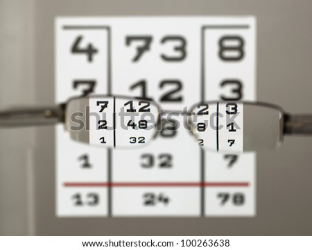 Eye test chart with eyeglasses - stock photo