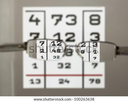 Eye test chart with eyeglasses - stock photo