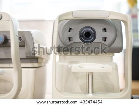 Eye test machine in the oculist office - stock photo