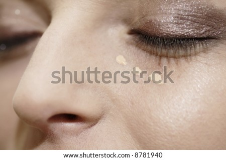 Eye - woman applying make up