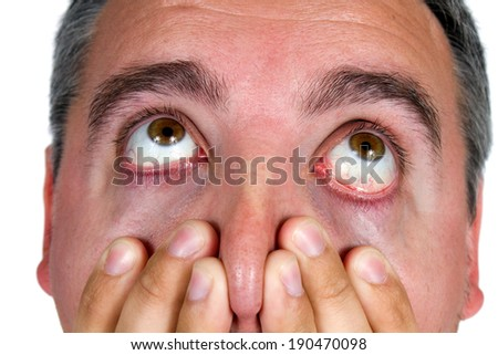 Eyeballs of man as he looks up in surprise and shock. - stock photo