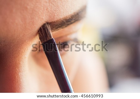 Eyebrow selective focus left eye and brush eyebrow