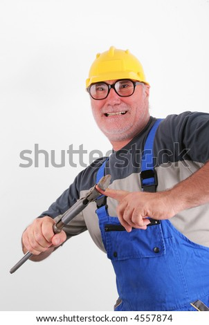 Eyeglassed worker compress his finger tool - stock photo