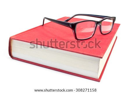 Eyeglasses and book isolated on white - stock photo
