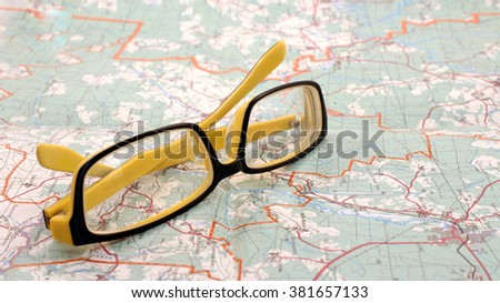 eyeglasses and map