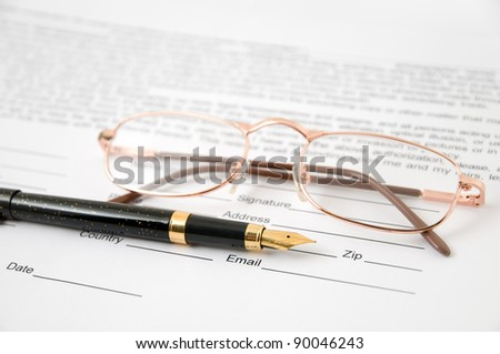 Eyeglasses and pen  lay on the document