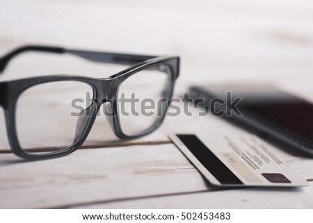 Eyeglasses, mobile phone and credit card.