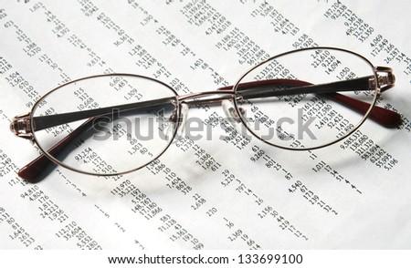 eyeglasses on account document - stock photo